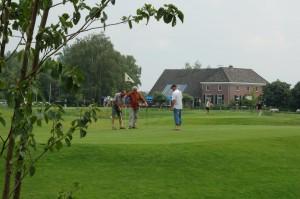 Golfbaanmetcluhuis